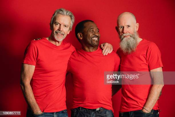 senior male friends laughing - red shirt stock pictures, royalty-free photos & images