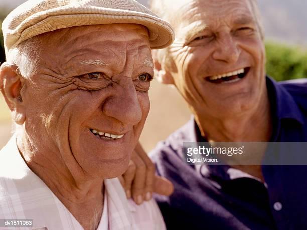 senior male friends smiling and laughing - alleen seniore mannen stockfoto's en -beelden