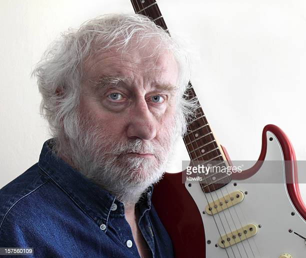 senior male guitar player beard white hair side lighting - facial hair stock pictures, royalty-free photos & images