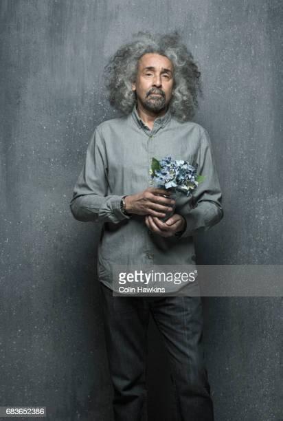 Senior Male Holding Flower arrangement