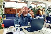 serious man using laptop