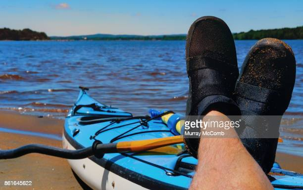 senior male paddler enjoying a kayak adventure - murray mccomb stock pictures, royalty-free photos & images