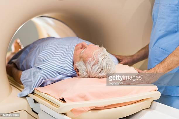 Senior male patient receiving MRI Scan.