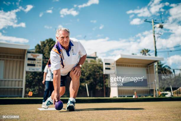 senior male playing bowls - match sport stock pictures, royalty-free photos & images