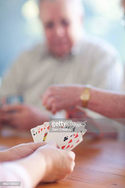 senior male playing cards with family - thinking of you card stock pictures, royalty-free photos & images