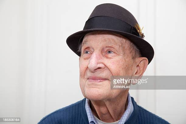 Senior male portrait 90 years old with hat