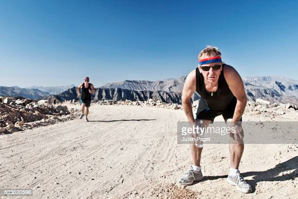 Senior Male running in Omani Mountains