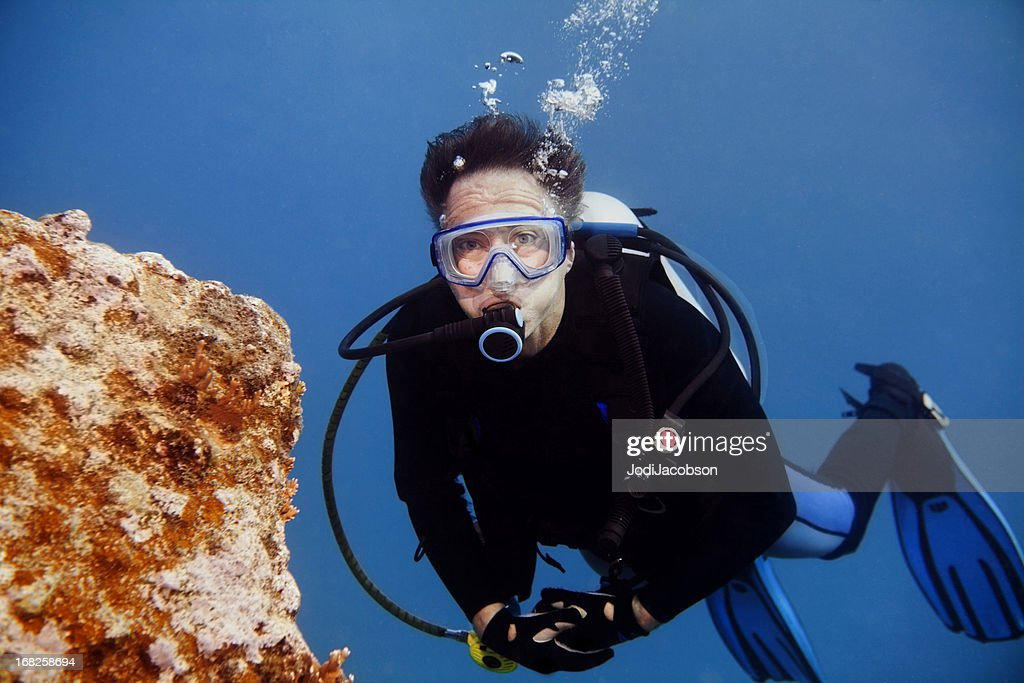 Senior Male Scuba Diver looking at camera with copy space : Stock Photo