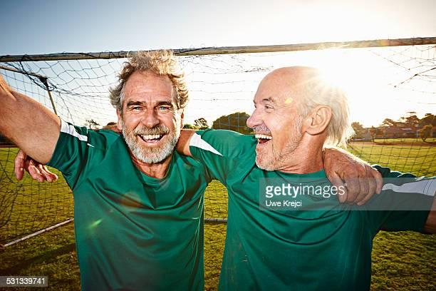 Senior male soccer players celebrating, portrait