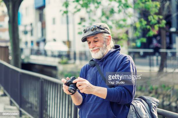 Senior male traveler in japan and takes pictures