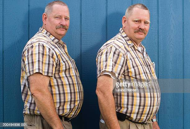 senior male twins wearing matching checked short sleeved shirts - homme gros ventre photos et images de collection