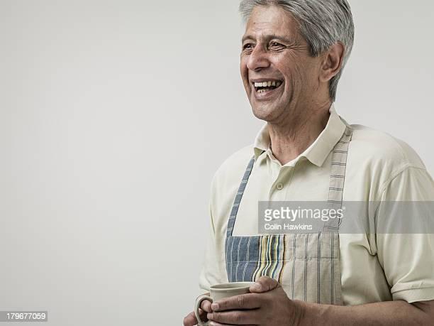 Senior male wearing apron