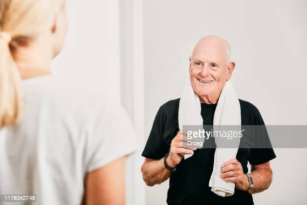 senior male working out - towel stock pictures, royalty-free photos & images