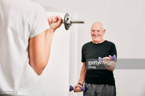 senior male working out - practising stock pictures, royalty-free photos & images
