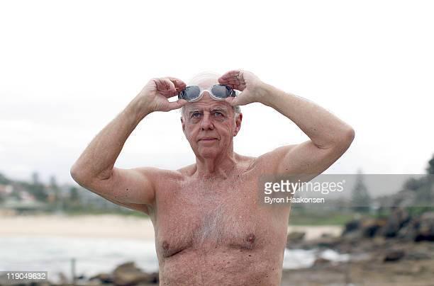 Senior man 70+ going for a swim