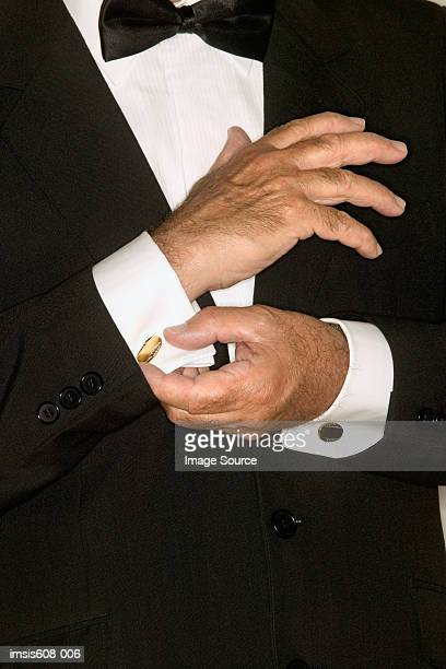 Senior man adjusting cuff links