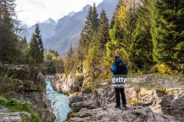 senior man admiring the soca valley gorges - eslovénia imagens e fotografias de stock