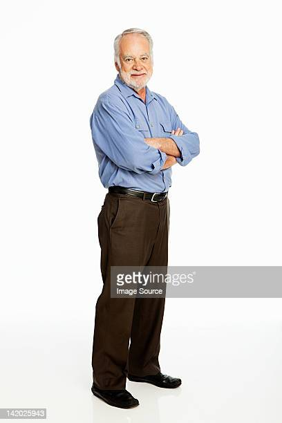Senior man against white background