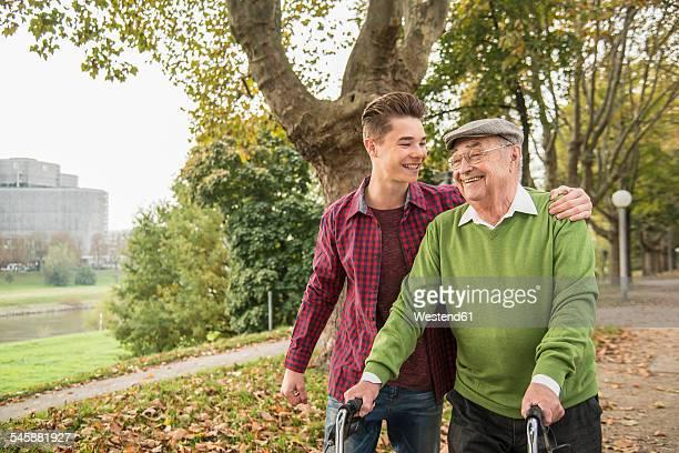 Senior man and adult grandson in park