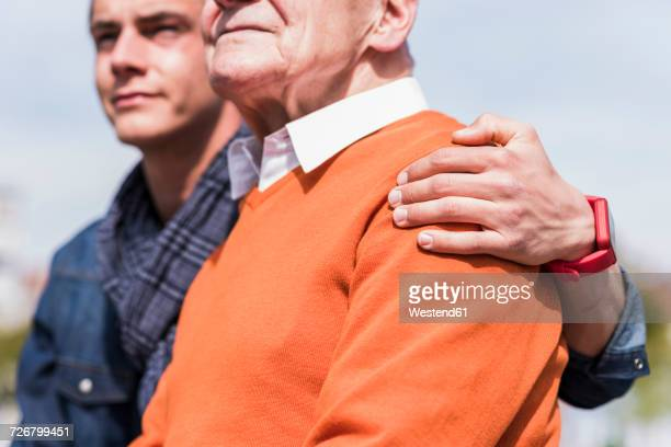 Senior man and adult grandson outdoors