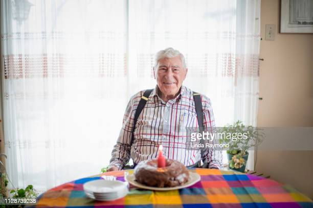 senior man and birthday cake - happy birthday canada stock pictures, royalty-free photos & images