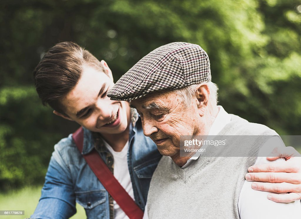 Senior man and his grandson in nature : Stock Photo