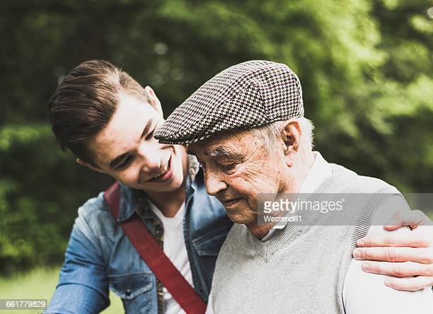 senior man and his grandson in nature - desaturated stock pictures, royalty-free photos & images