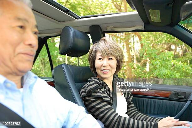 Senior man and mature woman in car
