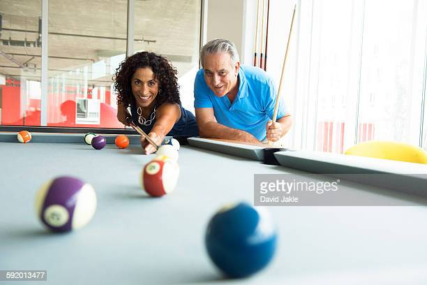senior man and wife playing on pool table - old men playing pool stock pictures, royalty-free photos & images