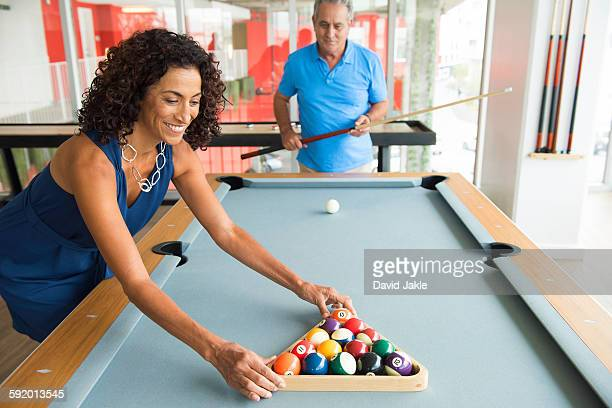 senior man and wife setting up pool table - old men playing pool stock pictures, royalty-free photos & images