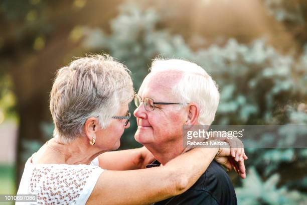 senior man and woman gazing into each other's eyes
