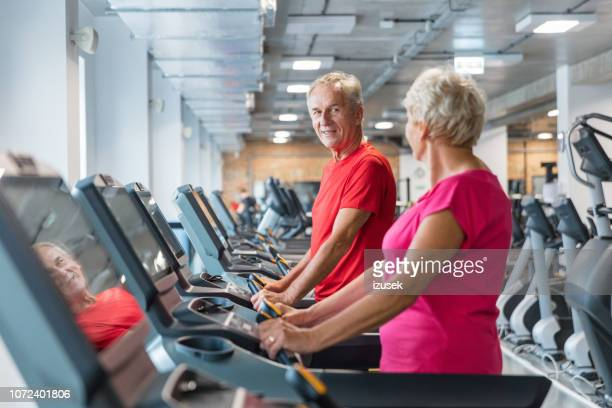 senior man and woman having rehabilitation at gym - drug rehab stock pictures, royalty-free photos & images