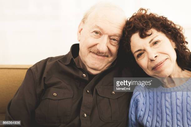 senior man and woman looking at camera - middle class stock pictures, royalty-free photos & images