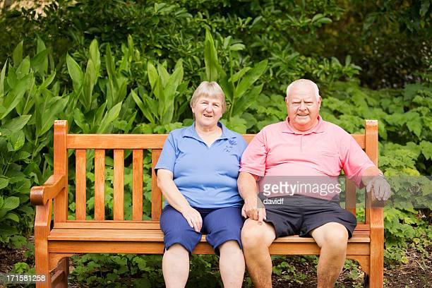 senior man and woman sitting - fat woman sitting on man stock pictures, royalty-free photos & images