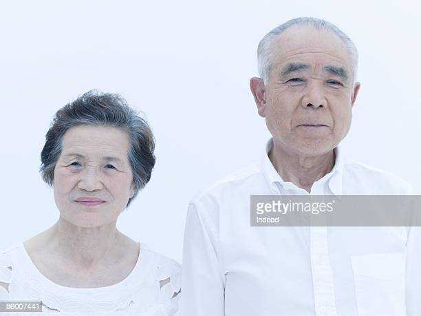 Senior man and woman standing side by side