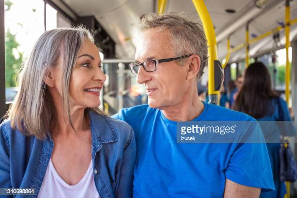 senior man and woman traveling in passenger bus - izusek stock pictures, royalty-free photos & images