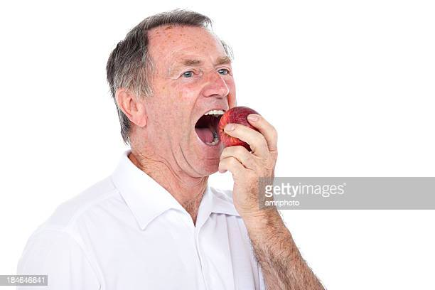 senior man apple bite