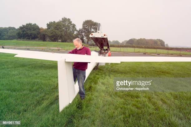 Senior man assembling glider