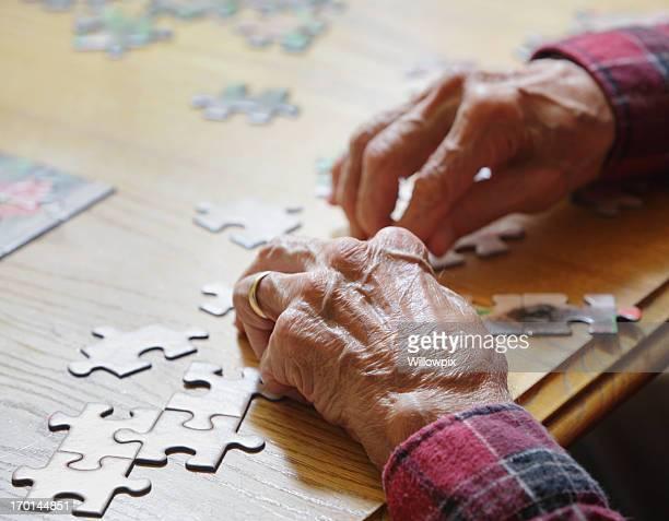 Senior Man Assembling Jigsaw Puzzle