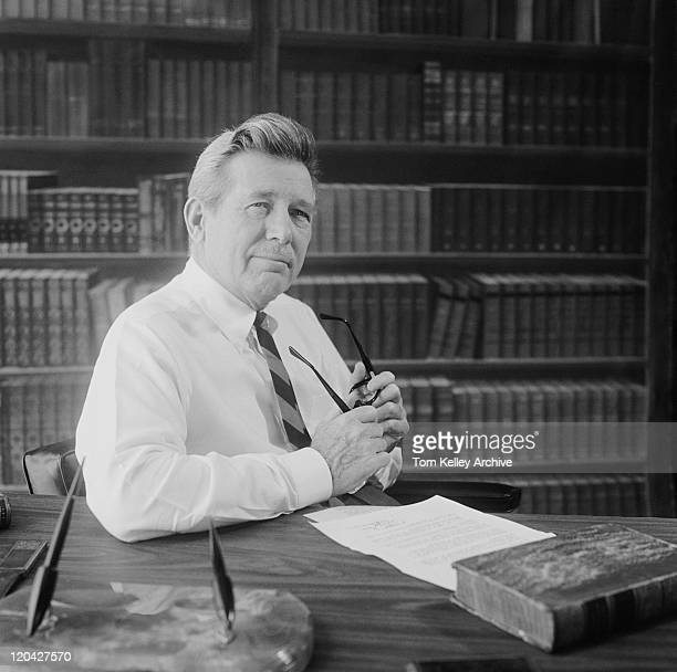 senior man at desk with bookshelf in background - shirt and tie stock pictures, royalty-free photos & images