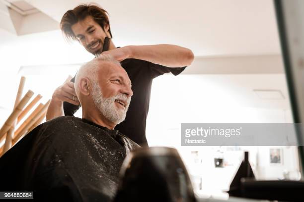 senior man at hairdresser - barber shop stock photos and pictures