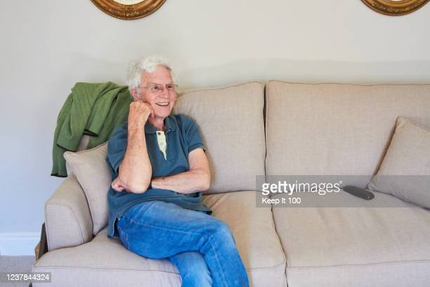 senior man at home - sitting stock pictures, royalty-free photos & images
