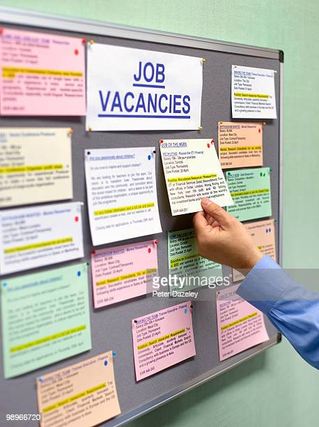 senior man at job vacancies board - unemployment stock pictures, royalty-free photos & images