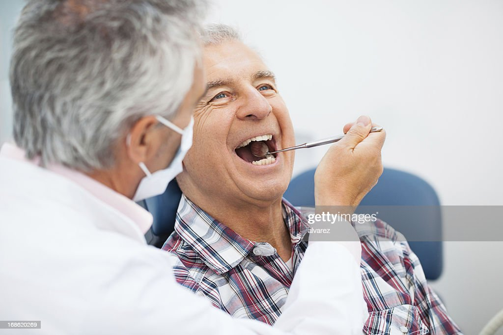 Senior man at the dentist : Stock Photo