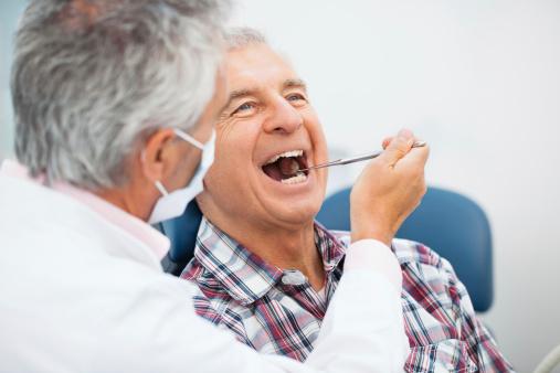 Senior man at the dentist 168620269