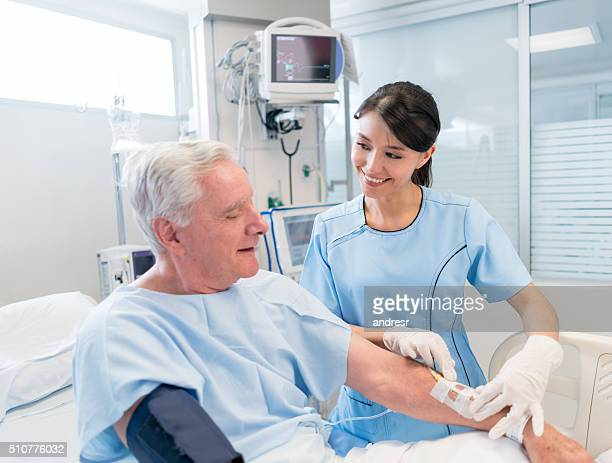 senior man at the icu - iv drip stock pictures, royalty-free photos & images