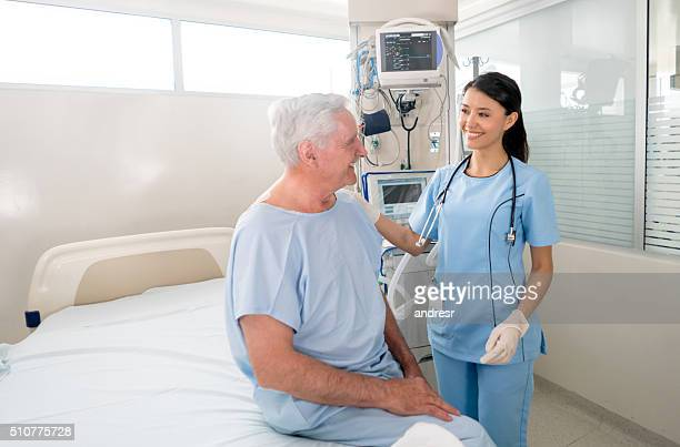 Senior man at the ICU talking to the nurse