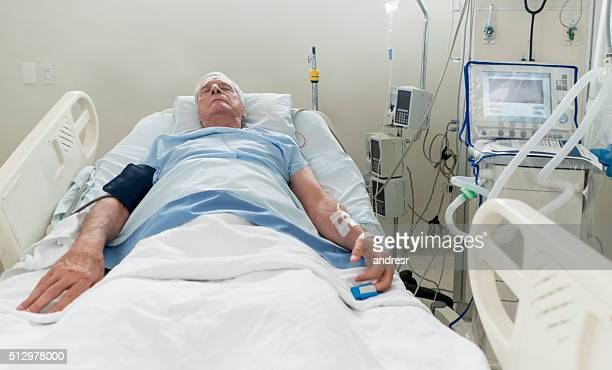 senior man at the intensive care unit - intensive care unit stock pictures, royalty-free photos & images