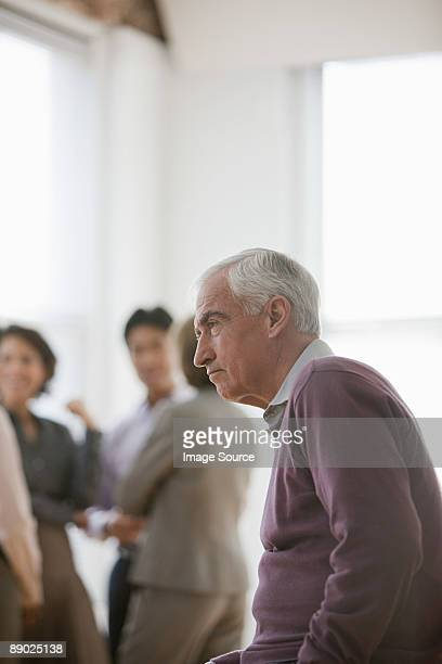 senior man at work - prejudice stock pictures, royalty-free photos & images
