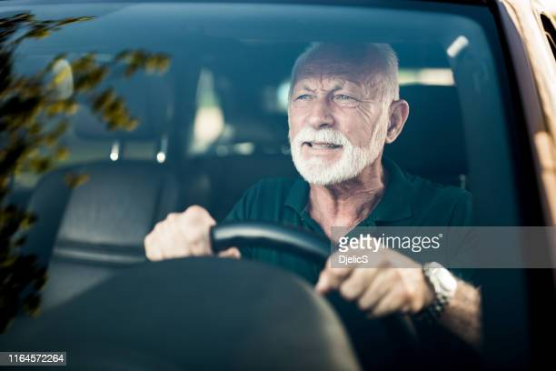 senior man avoiding a car accident. - avoidance stock pictures, royalty-free photos & images